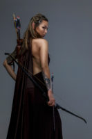 Beautiful elf woman woth bow and arrows. Isolated on grey. Fighter woman in armor witj bow By  Fxquadro